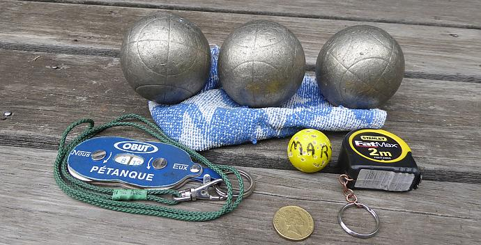 You don't need much gear to play:  boules, cosh, tape, counter, rag, $1